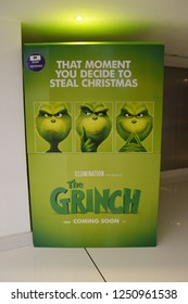 Dubai, UAE – November 27, 2018: A Standee of A 3D computer-animated Christmas comedy film The Grinch or Dr. Seuss' The Grinch (2nd story of How the Grinch Stole Christmas in 2000) at the theater.