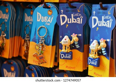 Dubai, UAE – November 29, 2018: Variety Key Chains and Magnets with the image of Burj Khalifa, Burj Al Arab Hotel and Camel are the popular souvenir from Dubai UAE.