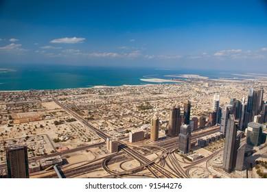 DUBAI, UAE. - NOVEMBER 29 : Dubai,the top view on Dubai from the tallest building in the world, Burj Khalifa, at 828m. on November 29, 2011 in Dubai, UAE. Day View