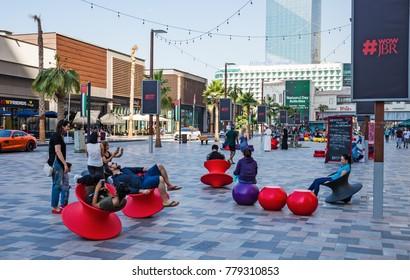 DUBAI, UAE - NOVEMBER 30, 2017: Tourists on the New public beach - Jumeirah Beach Residence JBR  with a 2 km promenade