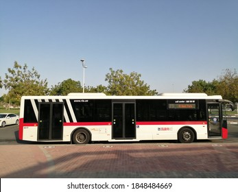 Dubai, UAE - November 6, 2020: Public transport bus of Dubai's Roads & Transport Authority (RTA) at a bus stop in the cosmopolitan city, where private car ownership is among the highest in the world.