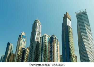 DUBAI, UAE - NOVEMBER 7, 2016: Luxury scyscrapers in marina Dubai, Unidet Arab Emirates. Dubai Marina in a summer day, United Arab Emirates.