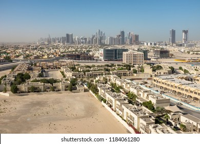 DUBAI, UAE - NOVEMBER 9, 2014: View over the low-rise Al Barsha district in Dubai, UAE, with the skyscrapers of Barsha Heights, Jumeirah Lakes Towers (JLT) and Dubai Marina in the distance