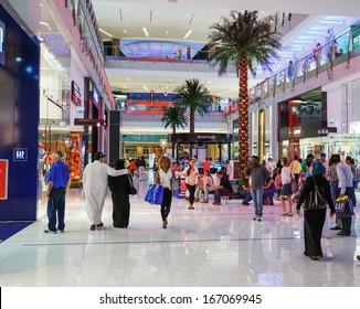 DUBAI, UAE - NOVEMBER 9: Inside modern luxury mall on November 9, 2013 in Dubai. At over 12 million sq ft, it is the world's largest shopping mall based on total area.