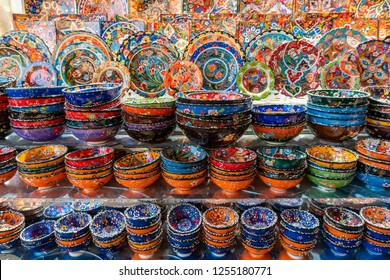 Dubai, UAE - Oct 11, 2018: Traditional colorful bowls and plates for sale in a market in Dubai