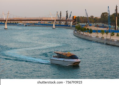 DUBAI, UAE - OCT 13, 2017:RTA water taxi Dubai pass through Dubai Water Canal on Shaikh Zayed Road