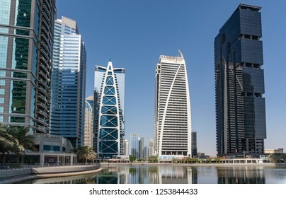 Dubai, UAE - Oct 13, 2018: Luxury apartment buildings in Jumeirah Lakes Towers in Dubai, UAE. It is a development with 80 towers along the edges of three artificial lakes.
