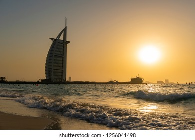 Dubai, UAE - Oct 13, 2018: View of Burj Al Arab from the Jumeirah Beach at sunset