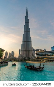 Dubai, UAE - Oct 15, 2018: View of boat cruising in the artifical lake near Burj Khalifa in Dubai