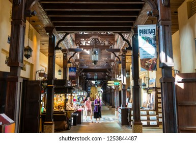 Dubai, UAE - Oct 15, 2018: Tourists visiting the Souk Madinat Jumeirah in Dubai. It is a traditional Arabian shopping mall in the largest resort in UAE.