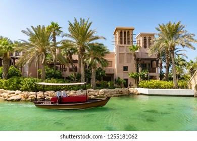 Dubai, UAE - Oct 15, 2018: Boat cruising along the waterway near Burj Al Arab