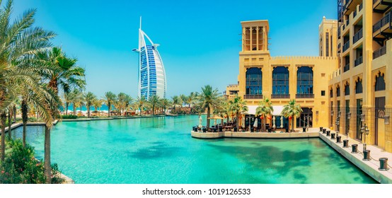 DUBAI, UAE - OCTOBER 06, 2016: Burj al Arab view from Madinat Jumeirah, Dubai. Beautiful view on hotel sail. Market and walking area with a beautiful view of the channels with sea water