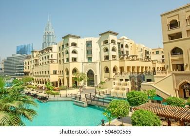 DUBAI, UAE - OCTOBER 11, 2016: A view of Souk al Bahar and the turquoise Burj Khalifa Lake surrounded by greenery
