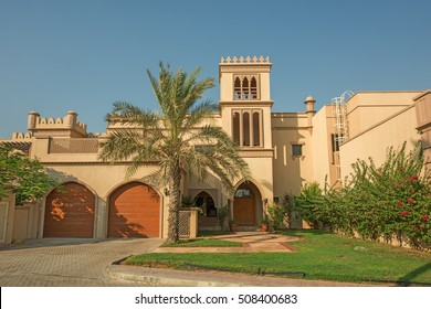 DUBAI, UAE - OCTOBER 11, 2016: A traditional arabian villa on the Palm Jumeirah.  The Palm Jumeirah is a man made island built in the shape of a Palm Tree