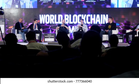 DUBAI, UAE - OCTOBER 12, 2017: World blockchain, Speakers Giving a Talk at Business Meeting. Audience in the conference hall. Business and Entrepreneurship. Speakers at Business Conference