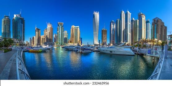 DUBAI, UAE - OCTOBER 14: Modern buildings in Dubai Marina, Dubai, UAE. In the city of artificial channel length of 3 kilometers along the Persian Gulf, taken on 14 October 2014 in Dubai.