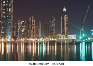 DUBAI, UAE - OCTOBER 15, 2014: view of Burj Khalifa Lake in Dubai at night. Dubai is the most populous city in the United Arab Emirates