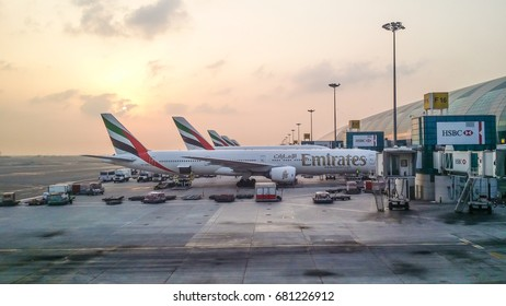 DUBAI, UAE - OCTOBER 19, 2014: Emirates flights at the Dubai International Airport, during the sunrise. Editorial Use Only.