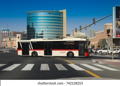 Dubai, UAE - October, 21, 2017: RTA Bus Dubai pass through Deira City Centre , Dubai city and Trafic signs on the street