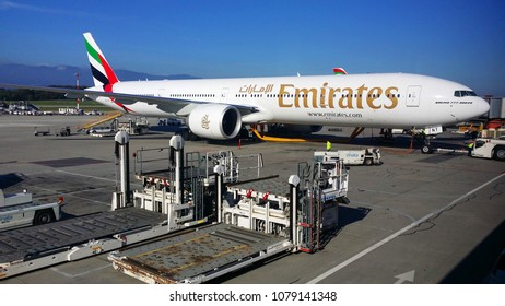 DUBAI, UAE - OCTOBER 26, 2014: An Emirates Boeing 777-300 jumbo jet standing by at the Dubai International Airport. Editorial Use Only.