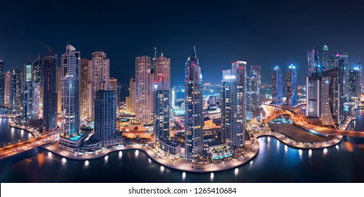 DUBAI, UAE - October 26: Dubai Marina Towers Glowing at night in a panoramic view with Atlantis the Palm in the background