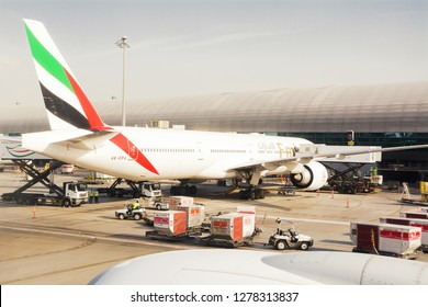 Dubai, UAE - October 31, 2018: Airplane of Emirates company, parked at Dubai's international airport dock, loading goods and preparing before the flight