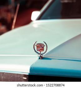 dubai, uae - October  5, 2019: Close-up of Cadillac icon logo  on retro car , Closeup shot of Cadillac logo or symbol on a Vintage car. Luxury line ofvehicles Produced by General Motors.
