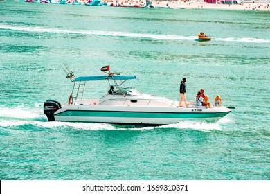 Dubai, UAE on 25 February, 2020. Marina JBR Blue Waters Ain Boat Beach Holidays Arab Yacht Cruise Evening City Life