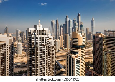 DUBAI, UAE - SEP 15: A skyline view of Jumeirah Lakes Towers on Sep 15, 2015 in Dubai, UAE. Dubai Marina is an artificial 3 km canal carved along the Persian Gulf shoreline
