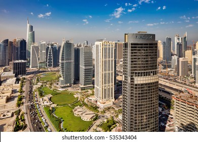 DUBAI, UAE - SEP 15: A skyline view of Jumeirah Lakes Towers on Sep 15, 2015 in Dubai, UAE. Dubai Marina is an artificial 3 km canal carved along the Persian Gulf shoreline
