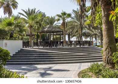 DUBAI, UAE - SEP 29: Sheraton Jumeirah Beach Resort - 5 star luxury resort (256 deluxe rooms) set in middle of landscaped gardens with over 200 palm trees, at September 29, 2012, Dubai, UAE. Garden.