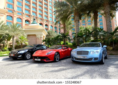 DUBAI, UAE - SEPTEMBER 11: The Atlantis the Palm hotel and limousines. It is located on man-made island Palm Jumeirah on September 11, 2013 in Dubai, United Arab Emirates