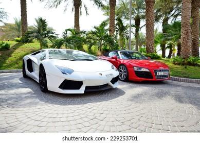 DUBAI, UAE - SEPTEMBER 11: The Atlantis the Palm hotel and luxury sport cars. It is located on man-made island Palm Jumeirah on September 11, 2013 in Dubai, United Arab Emirates