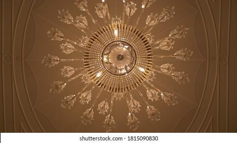 Dubai, UAE - September 14, 2020: Beautiful crystal chandelier at Palazzo Versace Dubai hotel. The 5-star hotel features grand Italian design incorporating signature Versace design elements.