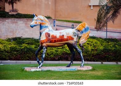 DUBAI, UAE - SEPTEMBER 15, 2017: A colored sculpture of the horse in Dubai Media City, United Arab Emirates