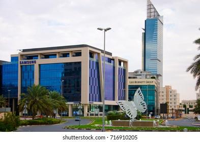 DUBAI, UAE - SEPTEMBER 15, 2017: Modern buildings with blue stained glass windows in Dubai Media City, United Arab Emirates