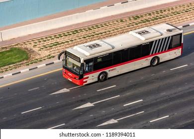 DUBAI, UAE - SEPTEMBER, 2018: Bus on the road in Dubai. RTA transportation. Above high view.