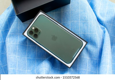 Dubai / UAE - September 21, 2019: Iphone 11 pro. New Midnight Green Apple Iphone 11 Pro in original box on blue background. Apple Iphone 11 Pro.  iphone 11 pro