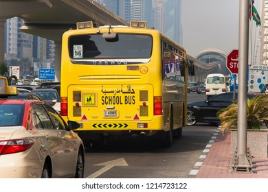 DUBAI, UAE - SEPTEMBER 25 2018: Dubai school bus on the street driving. United Arab Emirates