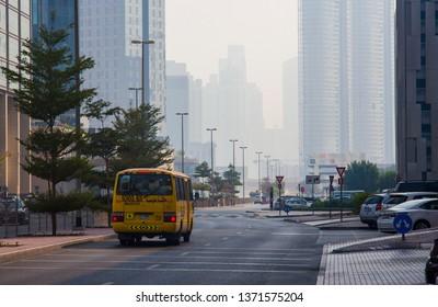 DUBAI, UAE - SEPTEMBER 25 2018: school bus driving in Dubai city street. UAE