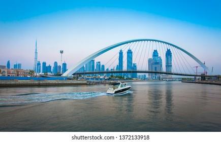 DUBAI, UAE - SEPTEMBER 26 2018: Tolerance bridge and boat in Dubai city, UAE
