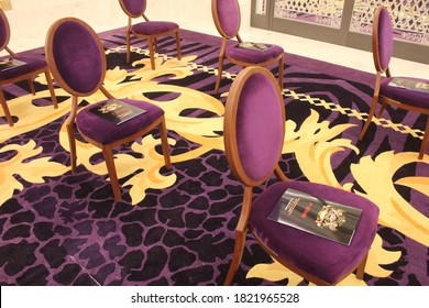 Dubai, UAE - September 26, 2020: Luxurious velvet chairs spaced apart to maintain social distancing as a health precaution against Covid-19 during an event at Palazzo Versace Dubai 5-star hotel.