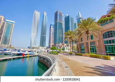 DUBAI, UAE - SEPTEMBER 27 2018: Dubai Marina city with skyscrapers and boats, United Arab Emirates