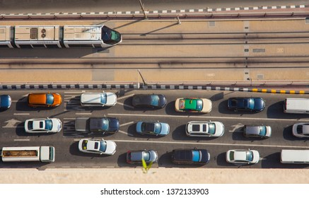 DUBAI, UAE - SEPTEMBER 27 2018: traffic with cars and tram in Dubai Marina. Aerial view
