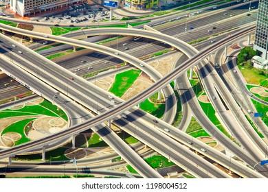 DUBAI, UAE - SEPTEMBER 28 2018: intersecion of roads with cars in Dubai city center, United Arab Emirates