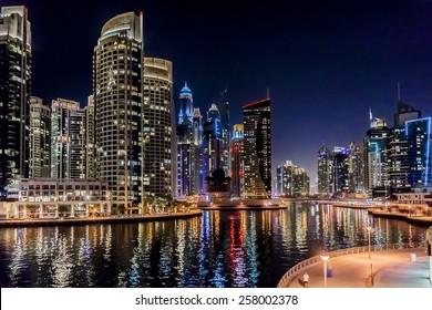 DUBAI, UAE - SEPTEMBER 29, 2012: Night view at modern skyscrapers in Dubai Marina. Marina - artificial canal city, carved along a 3 km stretch of Persian Gulf shoreline. Dubai, United Arab Emirates.