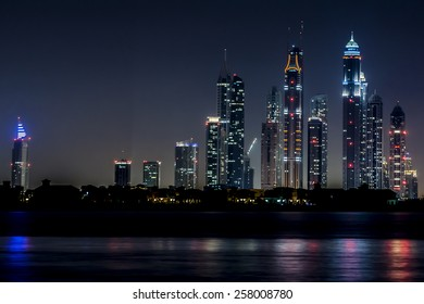 DUBAI, UAE - SEPTEMBER 29, 2012: Night view of Dubai Marina from Kempinski hotel (Palm Jumeirah). Dubai Marina - artificial canal city, carved along Persian Gulf shoreline.