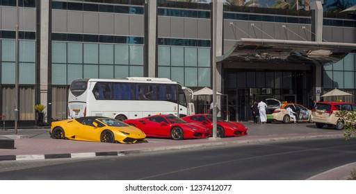 DUBAI, UAE - SEPTEMBER 29 2018: sports and luxry cars in front of Atana Hotel. Dubai city, UAE