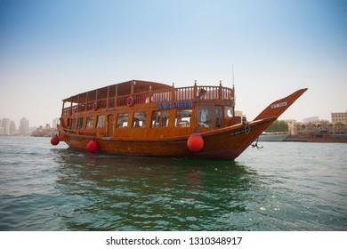 DUBAI, UAE - SEPTEMBER 29 2018: Dubai Tour cruise ship or traditional boat on the sea