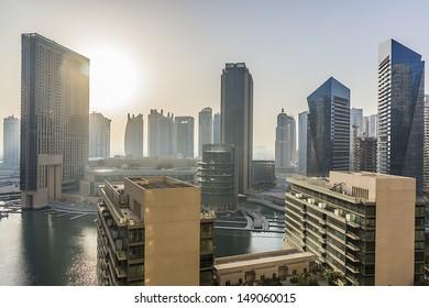 DUBAI, UAE - SEPTEMBER 29: Beautiful view of Dubai Marina at sunrise on September 29, 2012 in Dubai, UAE. Dubai Marina - artificial canal city, carved along Persian Gulf shoreline.